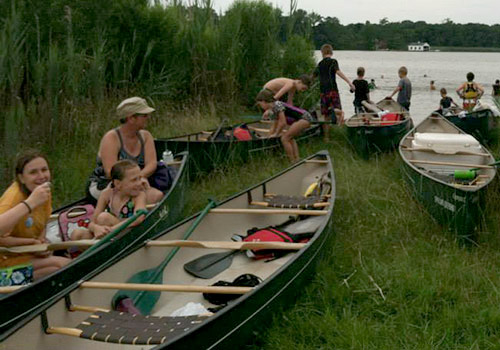 Campers and volunteers with canoes