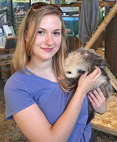 Sarah holding an opossum