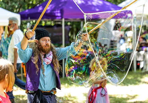 Performer making a very large bubble
