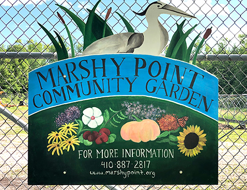 Community garden sign on fence